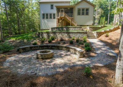 Southern Greenscapes Landscape Design & Construction | Rock Hill, SC | back yard after with fire pit, patio and retaining walls